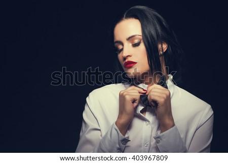 Woman undress tuxedo at night, sensuality and desire - stock photo