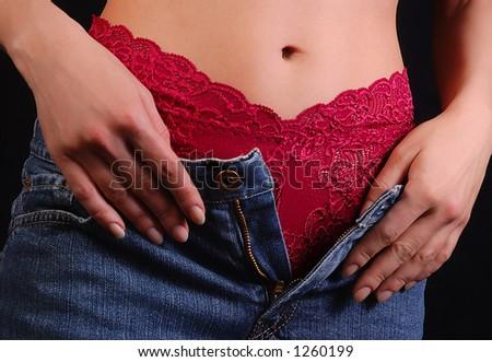Woman undresses - stock photo