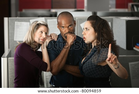 Woman unhappy with coworker's affair in office - stock photo