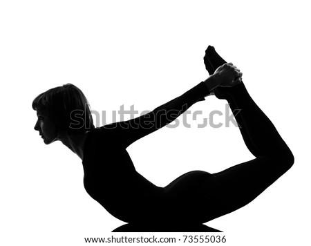 woman urdhva dhanurasana upward bow pose yoga posture position in silouhette on studio white background - stock photo