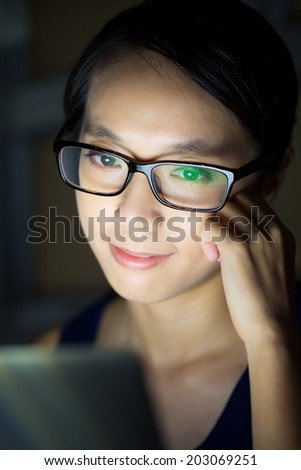 Woman use computer at night - stock photo