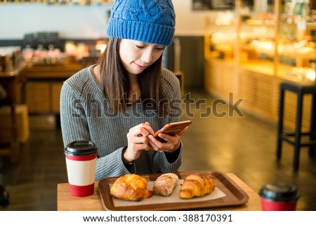 Woman use of cellphone in cafe at morning - stock photo