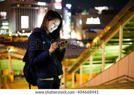 Woman use of mobile phone at night - stock photo
