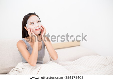 Woman use of the paper mask - stock photo