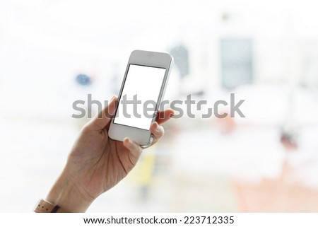 woman use smart phone in airport in airport - stock photo