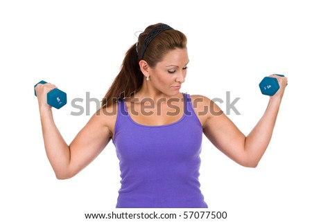 Woman uses dumbbells to do resistance weight training exercises. - stock photo