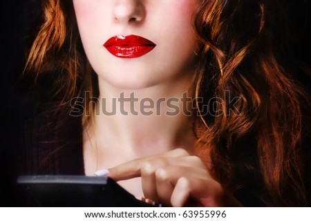Woman using a calculator - stock photo