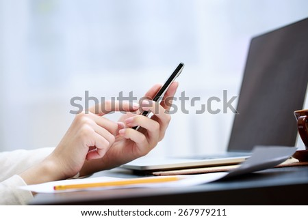Woman using a mobile phone  - stock photo