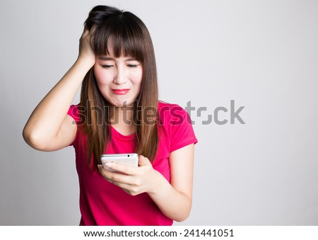 Woman using a smart phone and get bad news