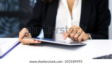 Woman using a tablet in her office.