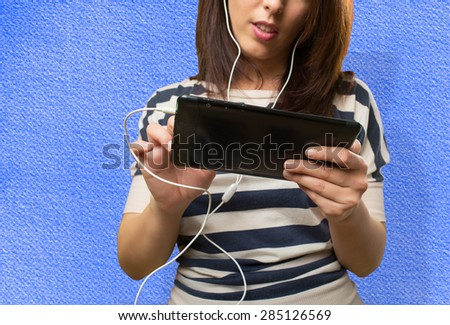 Woman using a tablet. Over blue background - stock photo