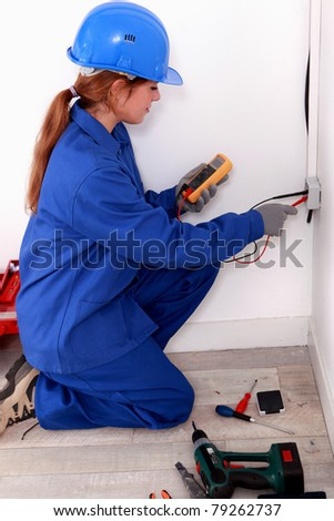 Woman using a voltage tester