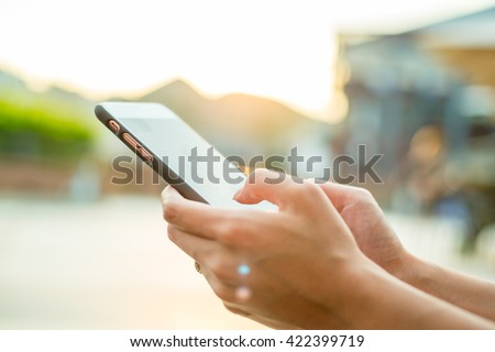 Woman using cellphone at outdoor - stock photo