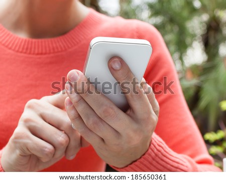 Woman using cellphone smart phone. - stock photo