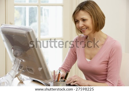 Woman Using Computer - stock photo