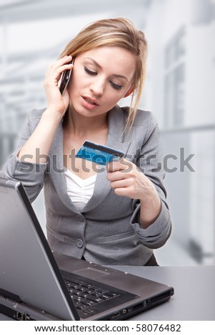 Woman Using Credit Card to Buy Online - stock photo