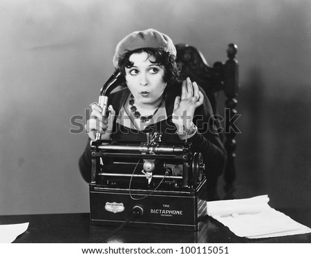 Woman using Dictaphone - stock photo