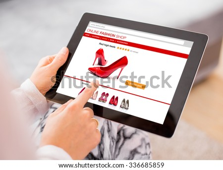 Woman using digital tablet to shop online  - stock photo