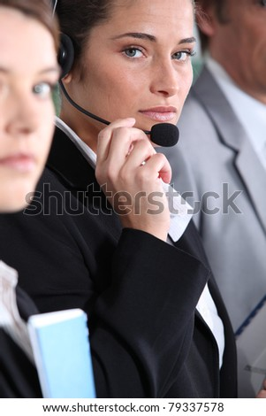Woman using headset - stock photo