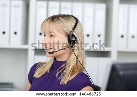 woman using headset, working at customer service - stock photo