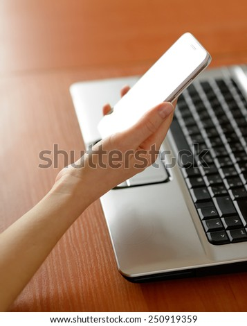 Woman Using Her Mobile Smart Phone at Home. Close-up of Mobile Phone - stock photo