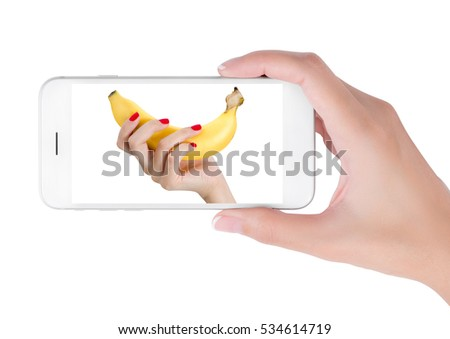 Woman using her smart phone searching sexy hand red nails holding banana. men's health and penis size sexual concept, Isolated on white background.