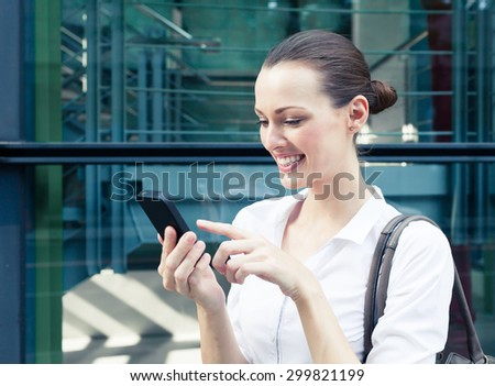 Woman using her smartphone. - stock photo