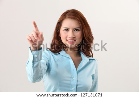 woman using invisible touch screen - stock photo