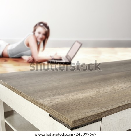 woman using laptop and desk