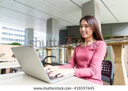 Woman using laptop computer - stock photo