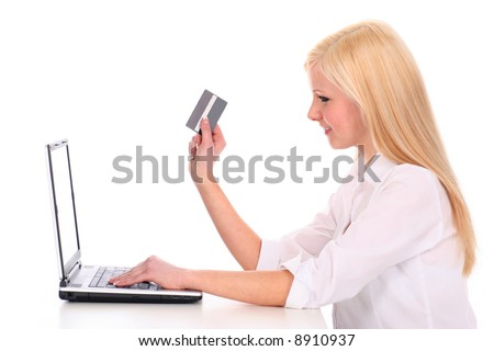 Woman using laptop, holding credit card