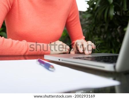 Woman using laptop notebook. - stock photo