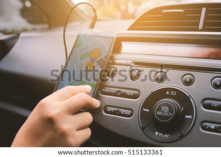 woman using map on smartphone.navigation in the car. gps on mobile