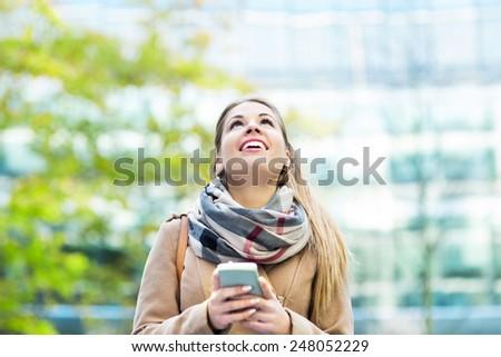 Woman using mobile phone  - stock photo