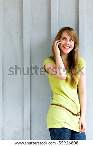 Woman Using Mobile Phone - stock photo