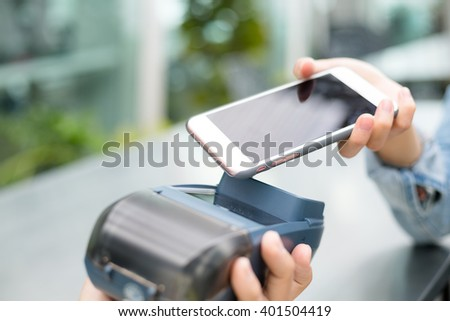 Woman using mobile phone for pay by the bill - stock photo