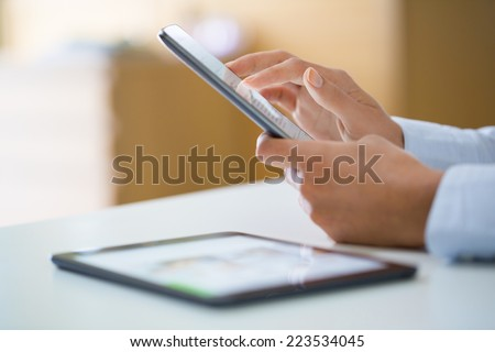 Woman using mobile phone, message sms email
