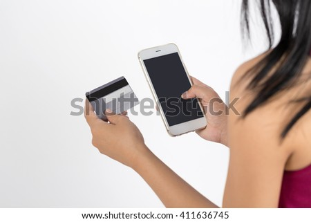 Woman using mobile phone verifies account balance on smart phone banking application, isolated on background - stock photo