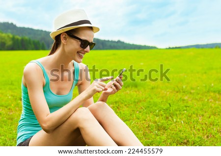 Woman using mobile smart phone outdoor - stock photo