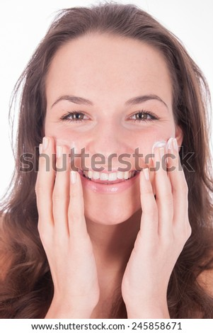 woman using moisturizer - wellness - skincare