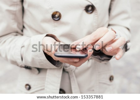 Woman using multi-gestures on smartphone - stock photo