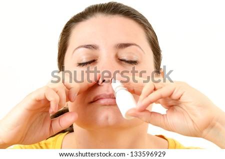 Woman using nasal spray - stock photo