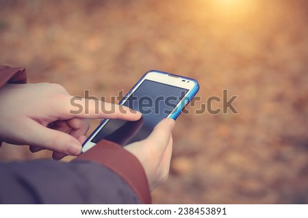 Woman using smart phone, detail - stock photo