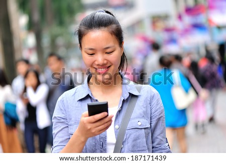 woman using smart phone on shopping street  - stock photo