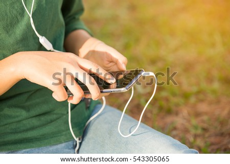 woman using smartphone  while listen music.
