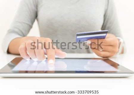 woman using tablet and credit card pay shopping online - stock photo
