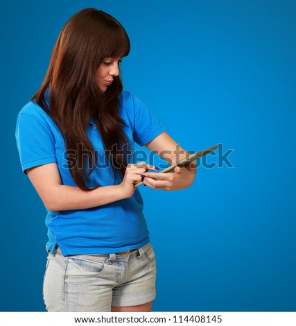 Woman Using tablet Isolated On Blue Background - stock photo
