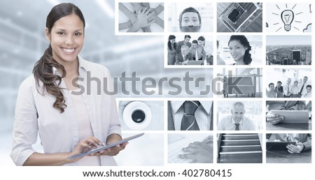 Woman using tablet pc against composite image of nervous businessman peeking over desk - stock photo