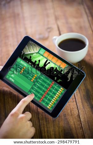 Woman using tablet pc against gambling app screen - stock photo