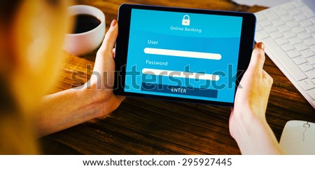 Woman using tablet pc against online banking - stock photo